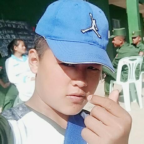 佤族帅哥的照片